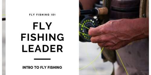 man holding fly fishing reel